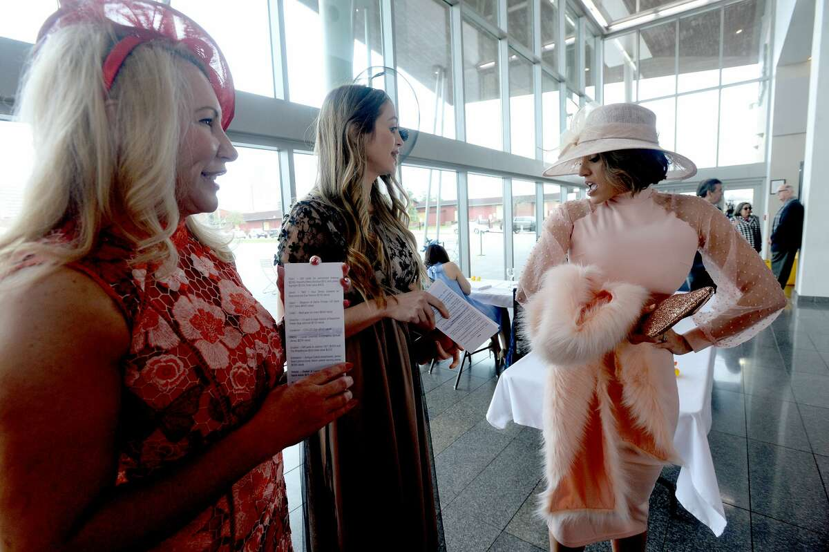 Guests, including (from left) Gina Browne, Nicki Pomonis and Lindsey Sanderson, dressed in derby hats and attire, socialize at the annual Shorkey Center Ducky Derby Luncheon Thursday at the Event Centre. A silent auction and special recognition of supporter Broussard's Mortuary rounded out the event. Photo taken Thursday, February 13, 2020 Kim Brent/The Enterprise