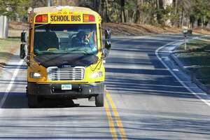 A school bus heads towards Ridgefield High School on Thursday afternoon at the end of the school day. The Ridgefield Board of Education is discussing moving the start time for the high school to later in the morning. January 21, 2016, in Ridgefield, Conn.