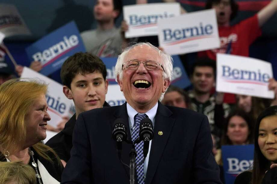 Vermont Sen. Bernie Sanders speaks  in Manchester on Tuesday, the day of the New Hampshire primary that he won over rivals Pete Buttigieg, Amy Klobuchar, Elizabeth Warren and Joe Biden. Photo: Timothy A. Clary /Getty Images / AFP or licensors