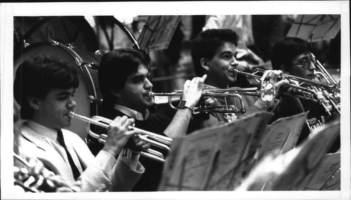 Colonie Center, New York - The trumpet section of the Empire State Youth Orchestra performs with the rest of the orchestra for a day long fund raising event. February 14, 1987 (Paul D. Kniskern, Sr./Times Union Archive)
