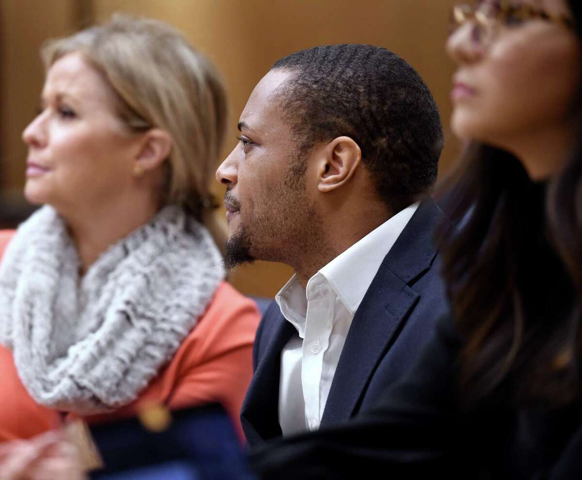 Christopher Calhoun, center, seated between attorneys Tara Knight, left, and Noor Abu-Hantash, appears in Superior Court in New Haven Feb. 13for the opening day of his trial in the 2011 killing of Isaiah Gantt.