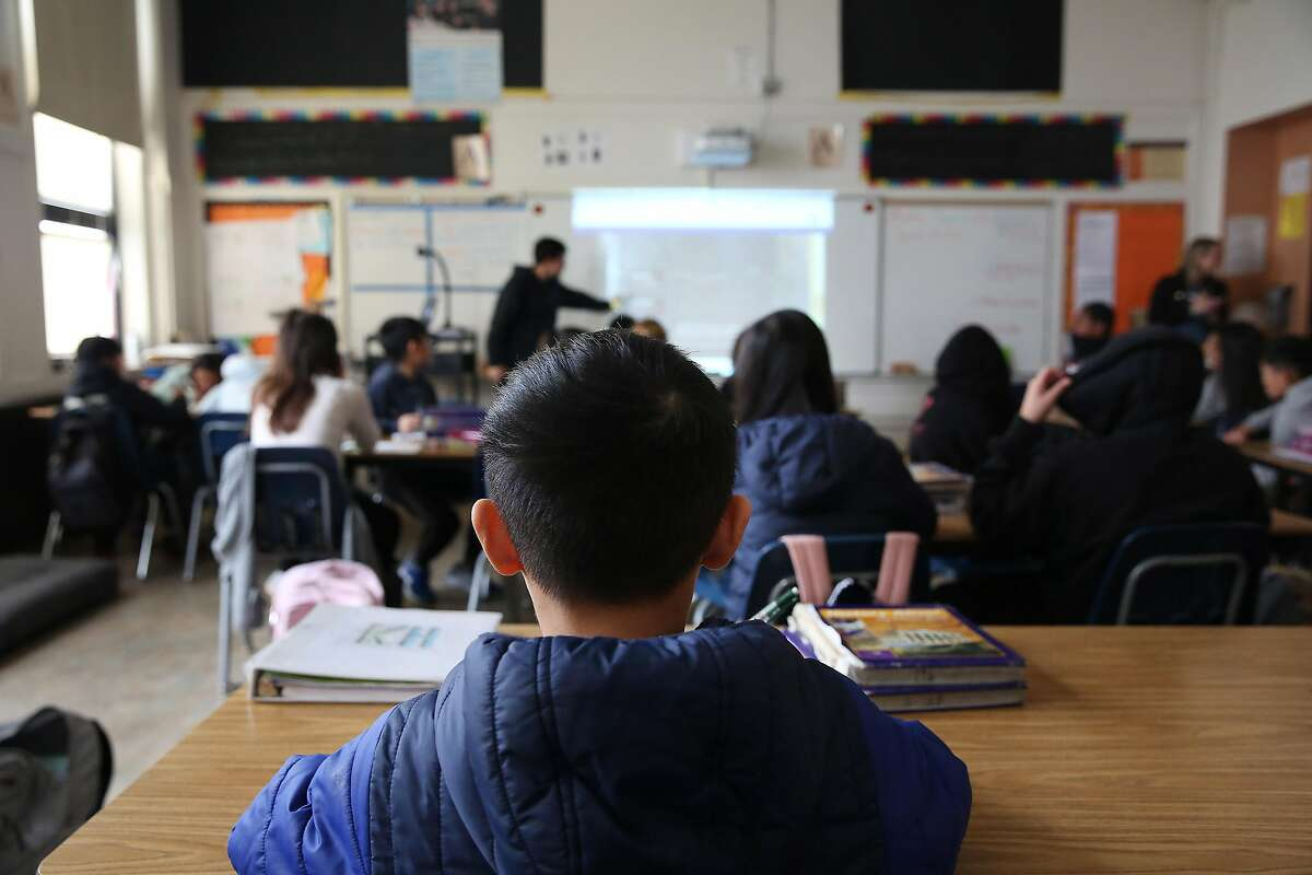 A student listens to instruction during an 8th grade science class at Aptos Middle School on Monday, January 27, 2020 in San Francisco, Calif.