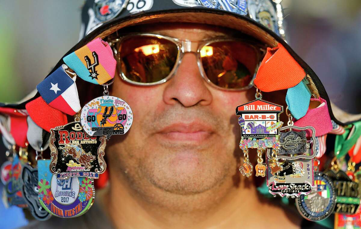 Arnold Salas wears medals on his hat during the Fiesta Fiesta event in 2017 at Hemisfair.