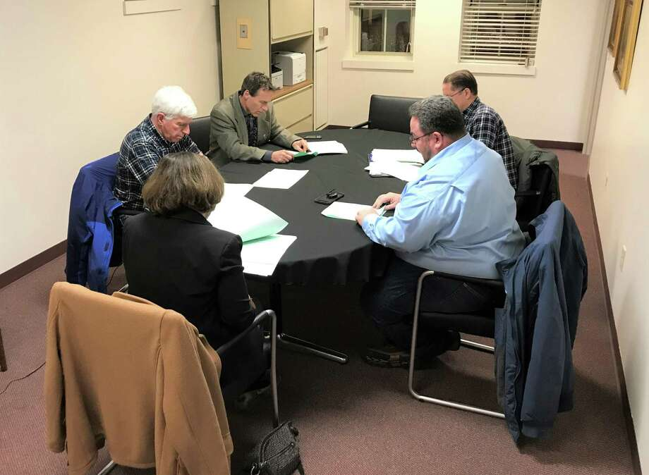 The Portland Board of Selectmen met in Town Hall to discuss the next steps in clean-up of riverfront property. Shown counter clockwise, are: Michael Pelton, Louis Pear, First Selectwoman Susan Bransfield, James Tripp and Ralph Zampano. Photo: Jeff Mill