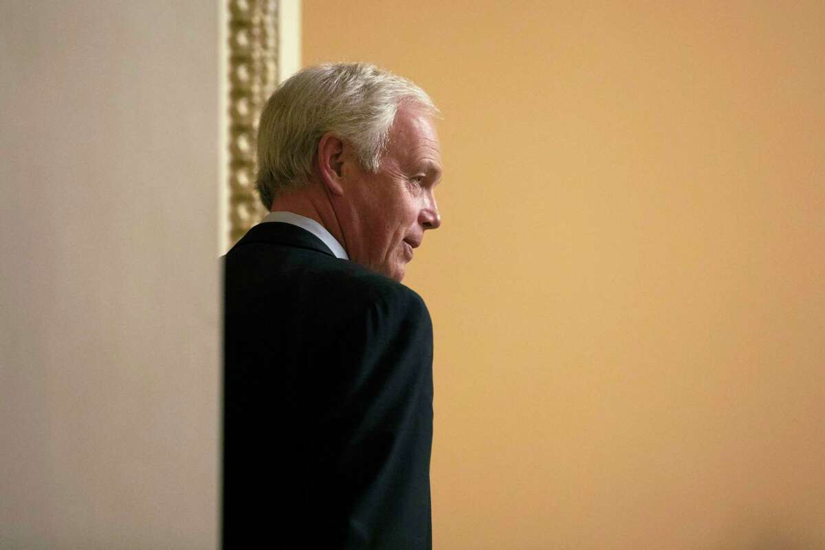Sen. Ron Johnson, R-Wis., walks on Capitol Hill in Washington, Friday, Jan. 31, 2020, during the impeachment trial of President Donald Trump on charges of abuse of power and obstruction of Congress. (AP Photo/ Jacquelyn Martin)