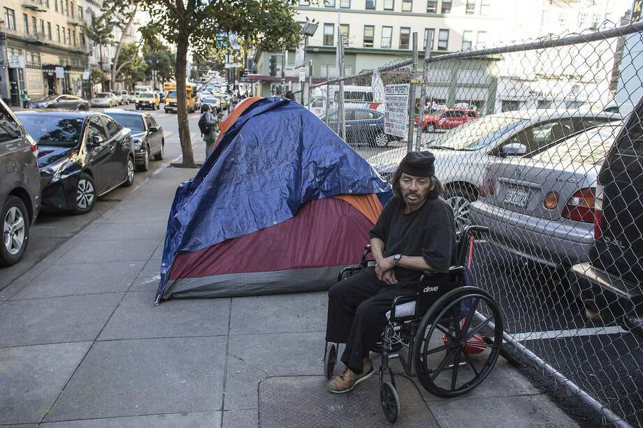 Michael Hwang, 67, sits in his wheelchair next to the parking lot at Jones and Turk streets in San Francisco. sco Mayor London Breed panned a state plan Thursday to create regional administrators to hand out homeless funding. Photo: Brian Feulner / Special To The Chronicle