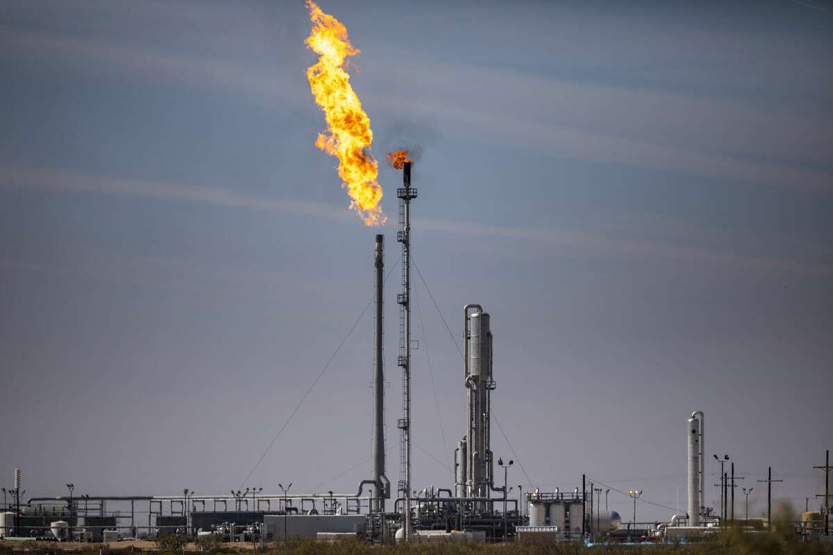 A gas flare is seen at Targa's Driver Gas Plant in Midland County. Occidental Petroleum is the first U.S. oil company to endorse the effort of World Bank, which is gathering commitments for its Zero Routing Flaring by 2030 initiative.