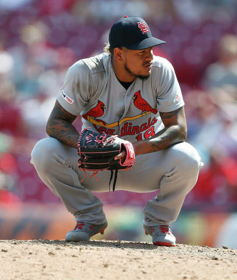 Cardinals closer Carlos Martinez crouches on the mound during a game against the Cincinnati Reds lst season. Photo: AP Photo