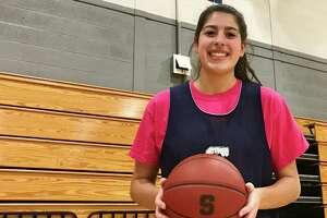 Staples basketball player Arianna Gerig in the school gymnasium. February 2020