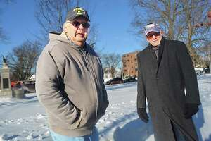 Greater Middletown Military Museum founder Ron Organek, left, and president Ken McClellan, right, are pleased at authorities' quick apprehension of a man they believe used an ax to break into the facility Tuesday and steal a nonworking firearm. Still, they are disappointed anyone would try to make off with even one piece of military history.