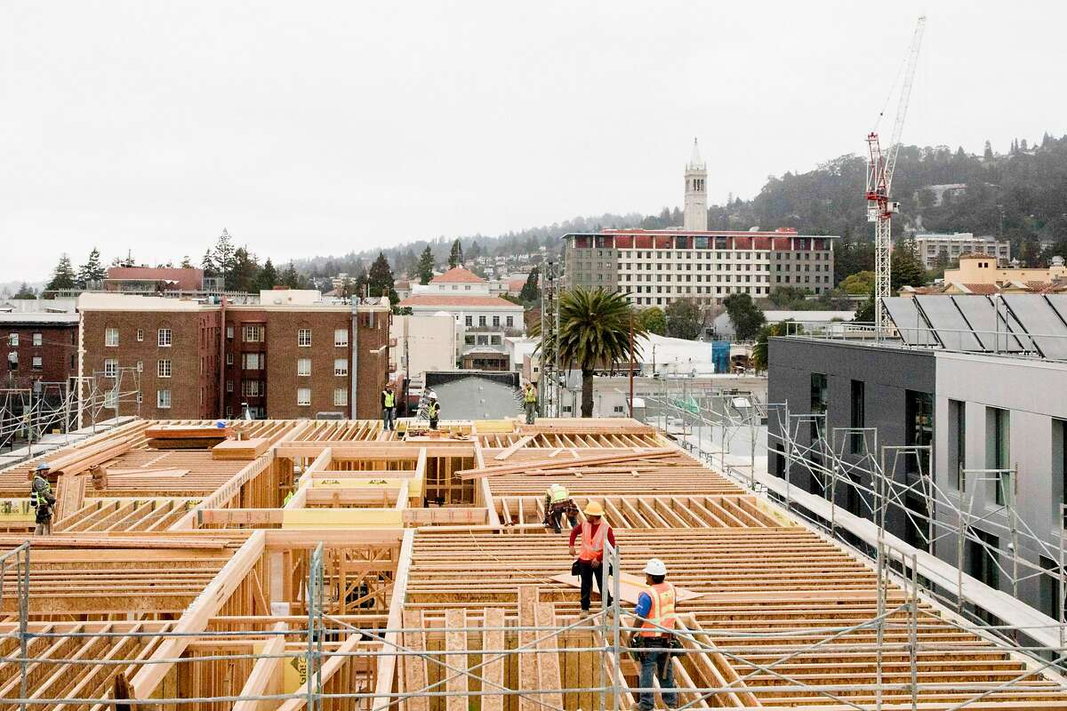 A construction project just north of West Builders' Enclave student housing development is seen from above along Telegraph Avenue in Berkeley, Calif. Thursday, February 13, 2020. Berkeley, a city long resistant to housing, is now home to a building boom, and with lots more on the way if economics allow.
