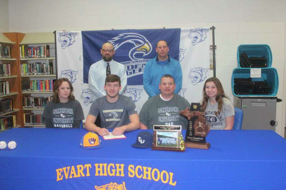 Evart'sJustinO'Dell(front, center) signs his letter of intent on Thursday to play baseball at Cornerstone University. At left is his mother, Amy O'Dell, and at right are his father,Jason O'Dell, and sister Natalie O'Dell. In back are, left, baseball coach Josh Johnson and athletic directorJay Wallace. (Pioneer photo/John Raffel)