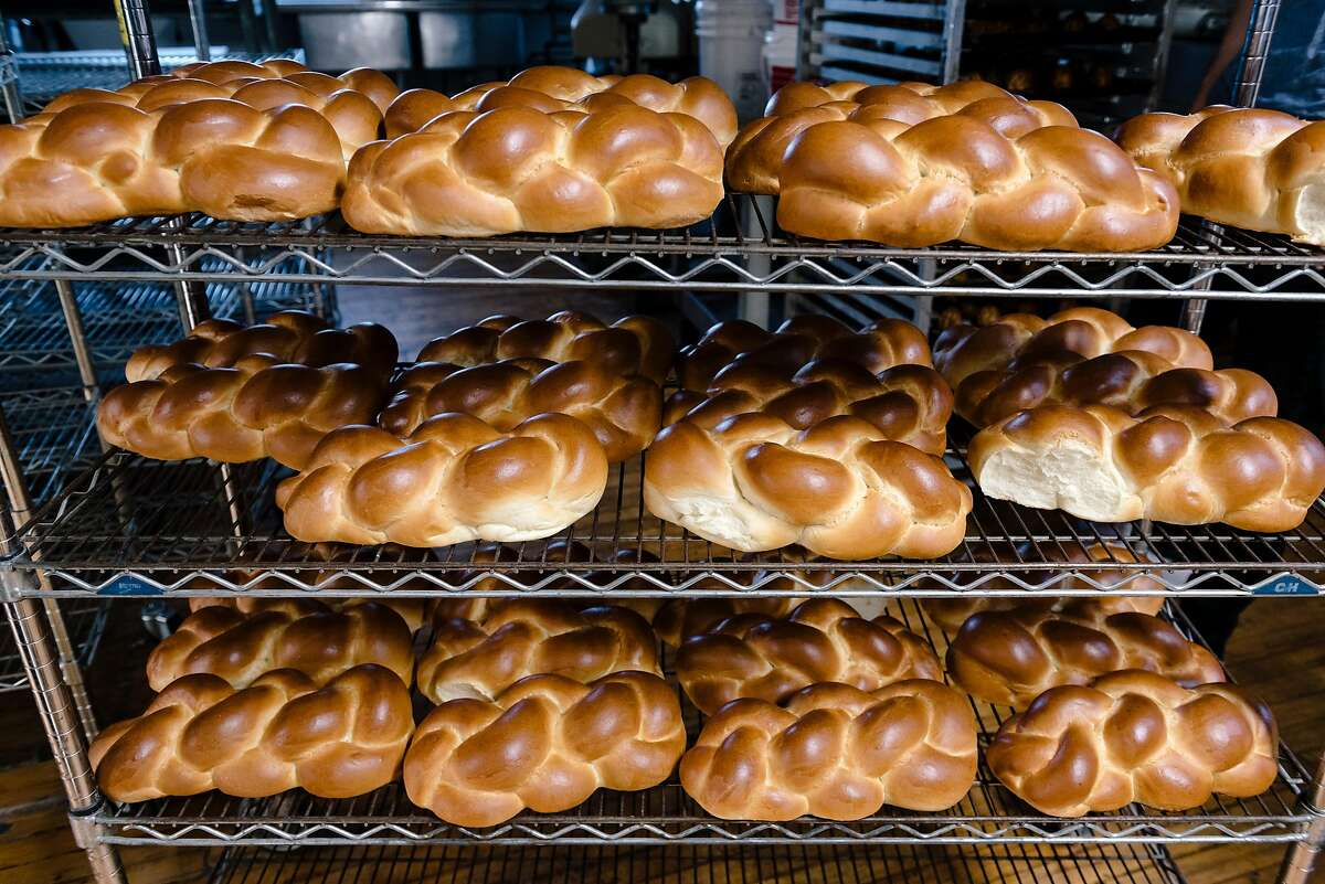 Freshly baked Challah bread cools on racks at the Grand Bakery in Oakland, California, U.S. on Monday, Feb. 10, 2020.