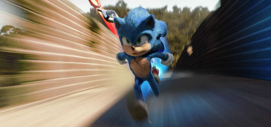 "This image released by Paramount Pictures shows Sonic, voiced by Ben Schwartz, in a scene from ""Sonic the Hedgehog ."" (Paramount Pictures/Sega of America via AP) / © 2019 Paramount Pictures and Sega of America, Inc. All Rights"