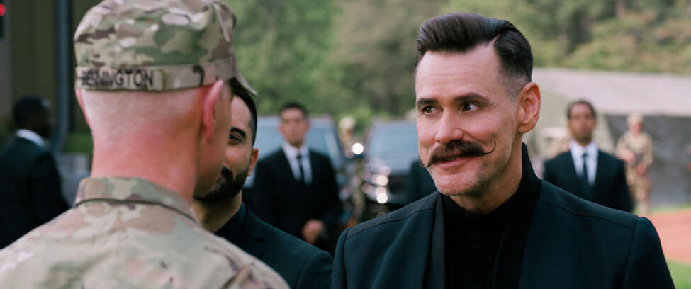 This image released by Paramount Pictures shows Neal McDonough, left, and Jim Carrey in a scene from