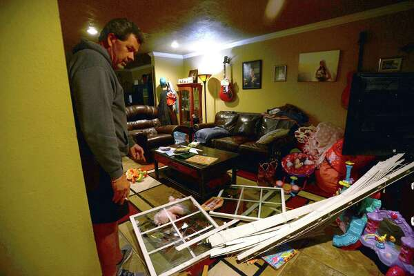 Roger Wallace looks over the damage to his Merriman Townhomes residence after the front window blew out following Wednesday morning's explosion at the TPC plant in Port Neches. Shards of glass littered the carpet and toys where his granddaughter plays. Thankfully he says the family were all asleep and in back rooms when the incident occurred. Photo taken Wednesday, November 27, 2019 Kim Brent/The Enterprise