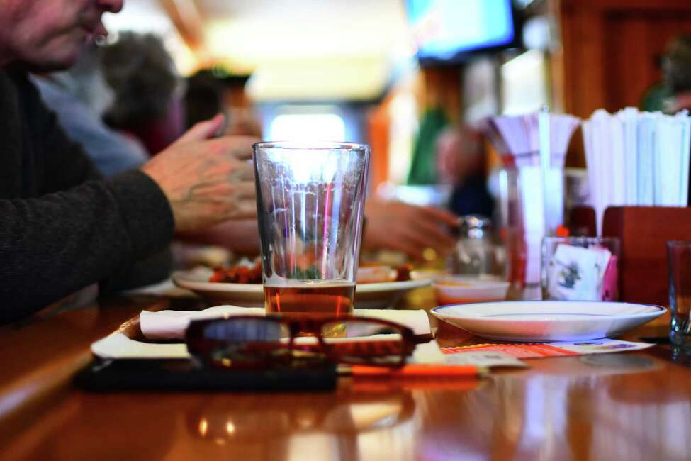 Reading glasses, phone, beer, lottery tickets: All set for Lunch at Casey's Restaurant in Rensselaer on Wednesday, Feb. 12, 2020.