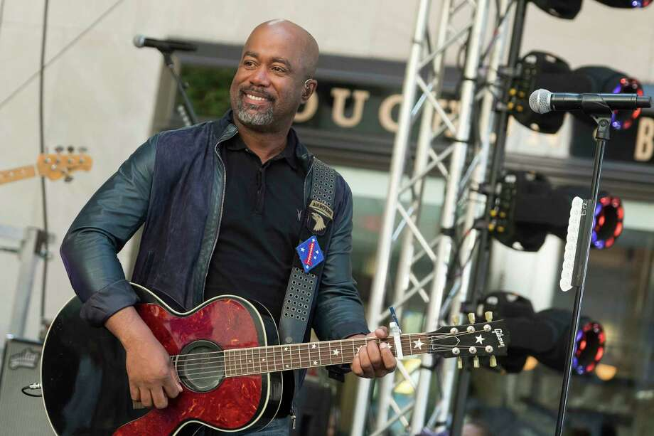 FILE - In this May 25, 2018 file photo, Darius Rucker performs on NBC's Today show at Rockefeller Plaza in New York.  The Country singer couldna€™t quite believe it when he was surprised this week with the news that his song a€œWagon Wheela€ was certified eight times platinum, making it one of the top five most popular country singles ever.   On Wednesday, Feb. 12, 2020, Rucker stopped by the Country Music Hall of Fame and Museum to his items in an exhibit, but his label, Universal Music Group Nashville, surprised him with a plaque featuring eight platinum-colored records.  (Photo by Charles Sykes/Invision/AP, File) Photo: Charles Sykes / 2018 Invision