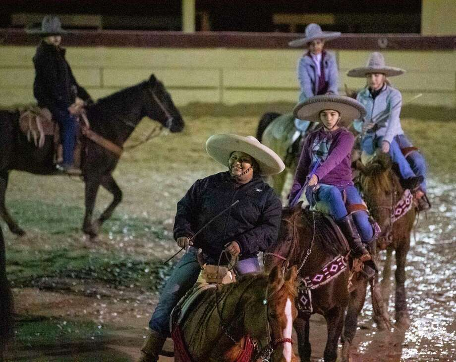 Kristy Escamilla, front, and other members of Escaramuza las Coronelas practice on Feb. 12. A reader applauds the San Antonio Stock Show & Rodeo for its  historic showcase. Photo: Billy Calzada /Staff Photographer / ***MANDATORY CREDIT FOR PHOTOG AND SAN ANTONIO EXPRESS-NEWS /NO SALES/MAGS OUT/TV