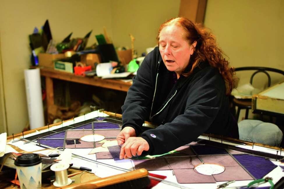 Darlene Benedict, owner of B&D Glass Crafters in Rensselaer, on Wednesday, Feb. 12, 2020, works on a custom glass insert for a door for a customer's Brooklyn home. Benedict worked for the company for a decade before buying it in 1997.