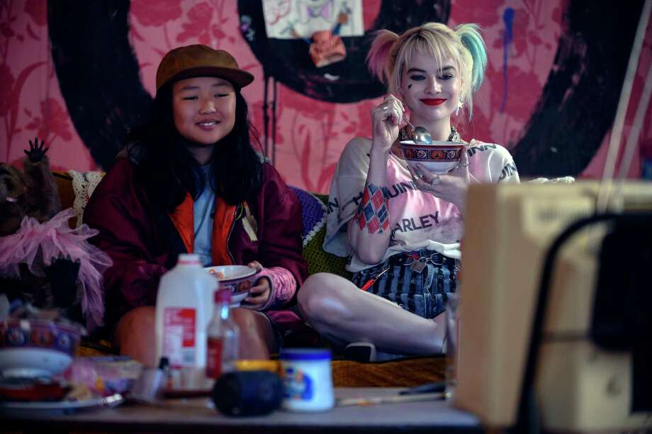 """This image released by Warner Bros. Pictures shows Ella Jay Basco, left, and Margot Robbie in a scene from """"Birds of Prey."""" (Claudette Barius/Warner Bros. Pictures via AP) Photo: Claudette Barius / © 2019 Warner Bros. Entertainment Inc. All Rights Reserved."""