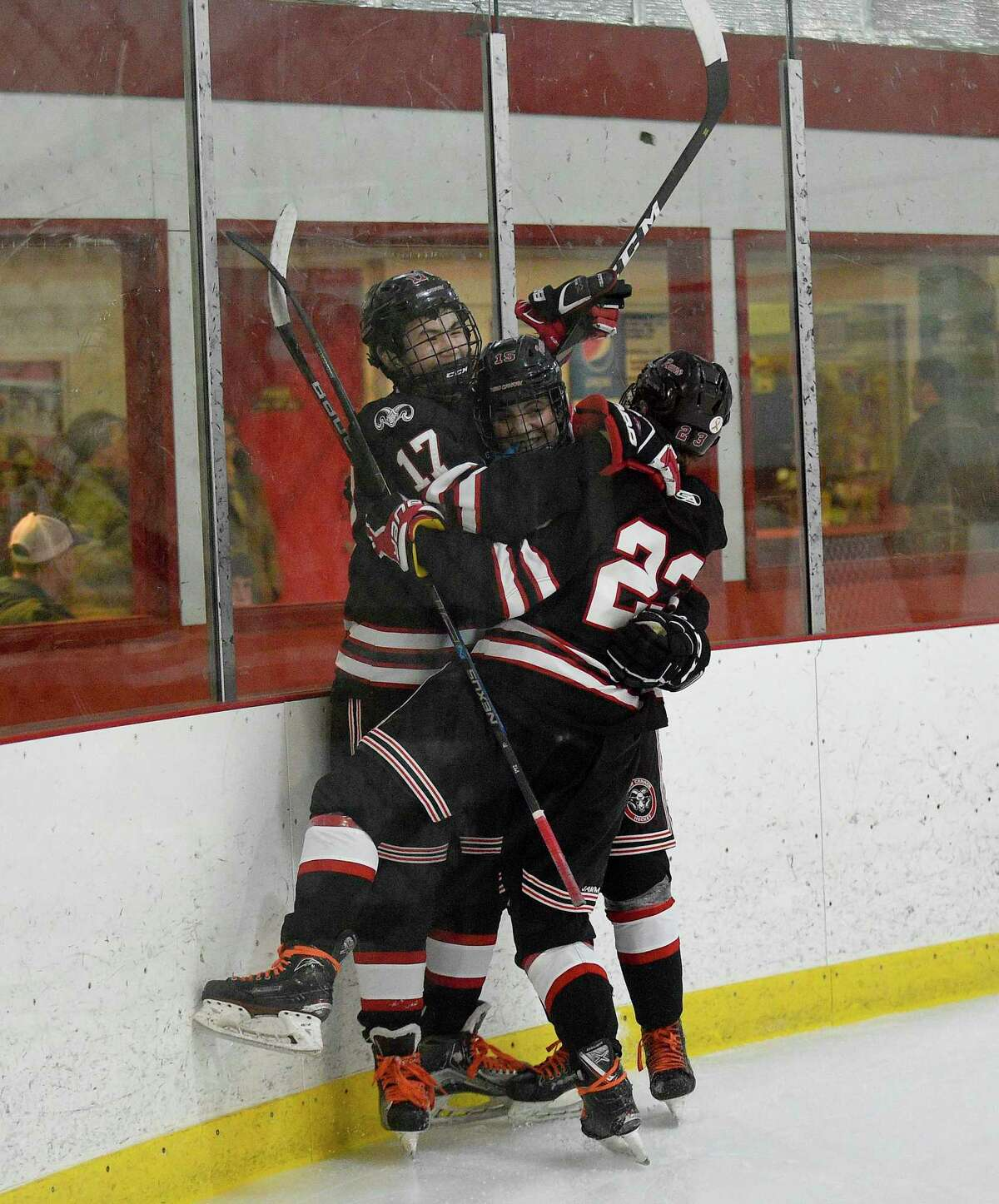 New Canaan's Justin Wietfeldt (17) celebrates his goal against Greenwich in an FCIAC boys hockey game at Dorothy Hamill Ice Rink on Thursday in Greenwich. No. 5 New Canaan defeated No. 4 Greenwich 3-2.