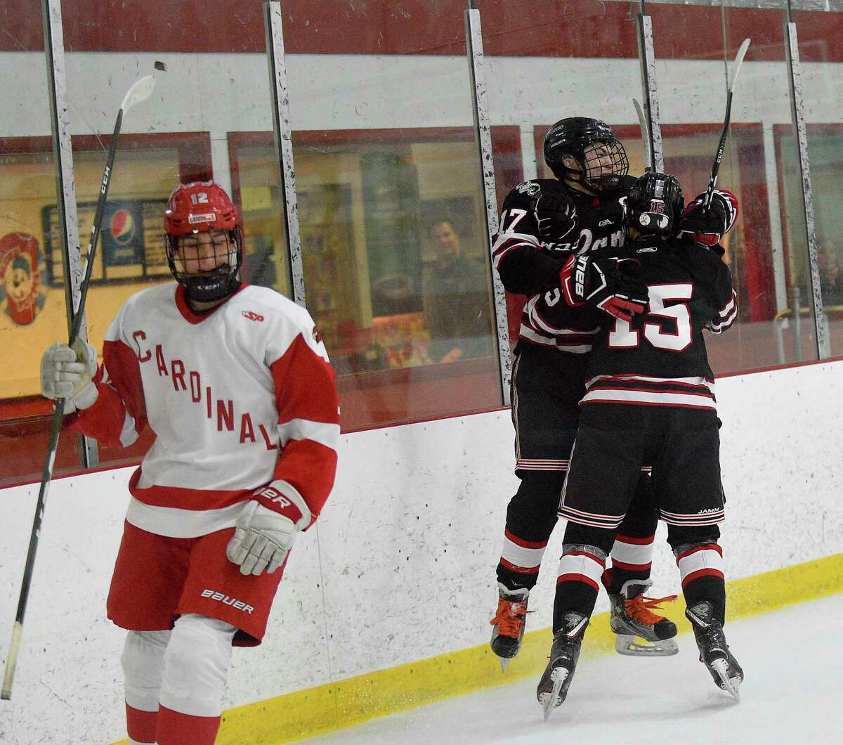 New Canaan's Justin Wietfeldt (17) celebrates his goal with Nicholas Megdanis (15) against Greenwich in an FCIAC boys hockey game at Dorothy Hamill Ice Rink on Feb. 13, 2020 in Greenwich Connecticut. No. 5 New Canaan defeated No. 4 Greenwich 3-2.