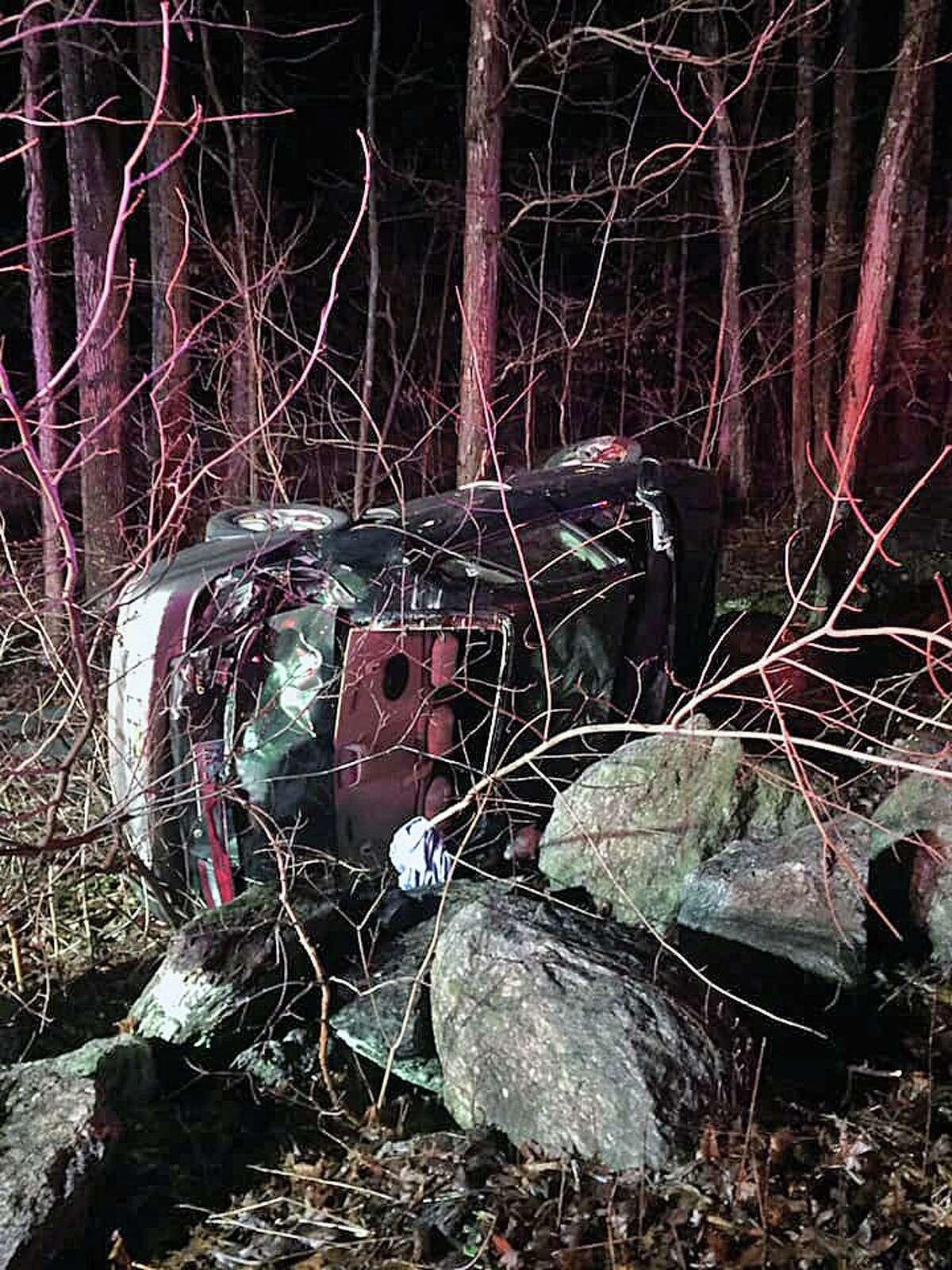 A rollover crash on Hattertown Road in Monroe, Conn., on Thursday, Feb. 13, 2020.