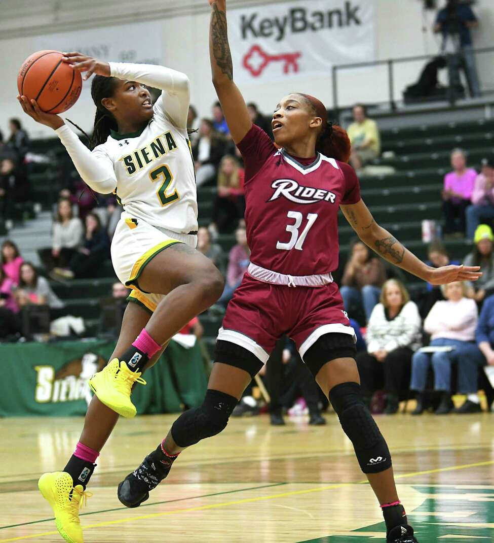 Siena's Amari Anthony drives to the basket against Rider's Amari Johnson during a game at Siena College on Thursday, Feb. 13, 2020 in Loudonville, N.Y. (Lori Van Buren/Times Union)