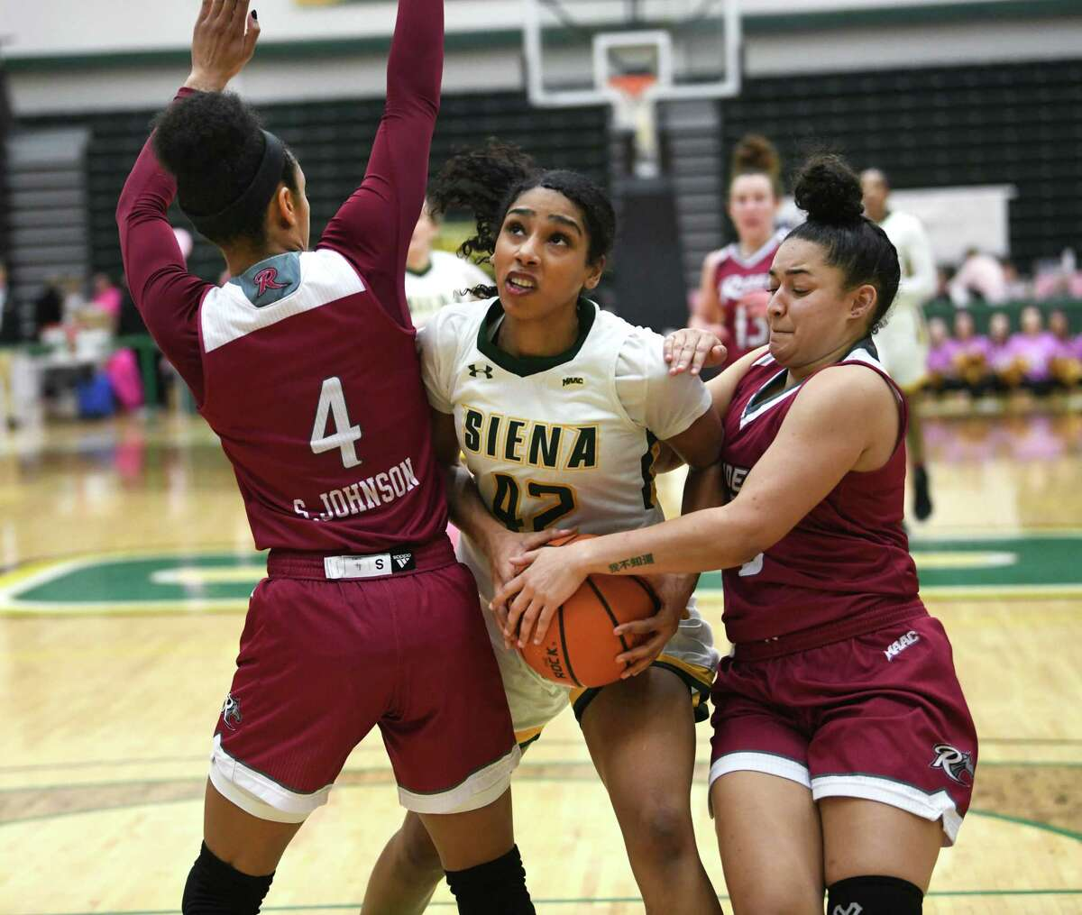 Siena's Sabrina Piper drives to the basket against Rider's Stella Johnson, left, and Amanda Mobley during a game at Siena College on Thursday, Feb. 13, 2020 in Loudonville, N.Y. (Lori Van Buren/Times Union)