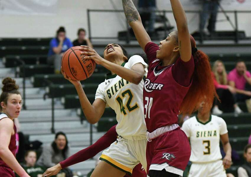Siena's Sabrina Piper drives to the basket against Rider's Amari Johnson during a game at Siena College on Thursday, Feb. 13, 2020 in Loudonville, N.Y. (Lori Van Buren/Times Union)