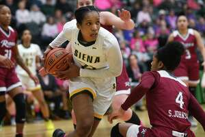 Siena's Lala Watts drives past Rider's Stella Johnson during a game at Siena College on Thursday, Feb. 13, 2020 in Loudonville, N.Y. (Lori Van Buren/Times Union)