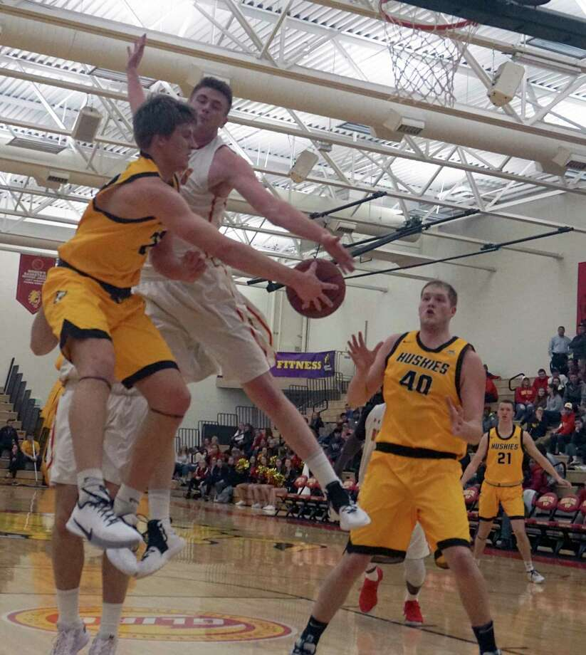 Bulldog senior Cole Walker reaches out to block a pass in the paint during the Ferris State's 76-71 win over Michigan Tech on Thursday night at Wink Arena. (Pioneer photo/Joe Judd)