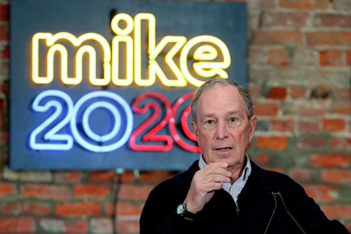 (FILES) In this file photo taken on December 21, 2019 2020 Democratic presidential hopeful and former New York Mayor Michael Bloomberg speaks during an event to open a campaign office at Eastern Market in Detroit, Michigan. - They're flooding the airwaves with campaign ads targeting Donald Trump. They're paying for it with their own money. Billionaires Mike Bloomberg and Tom Steyer have invested hundreds of millions of dollars in their efforts to win the Democratic Party's presidential nomination. And so far, it seems like that strategy is working. (Photo by JEFF KOWALSKY / AFP) (Photo by JEFF KOWALSKY/AFP via Getty Images)