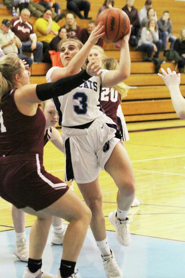 Brethren's Megan Cordes goes up for a shot in the lane Thursday night against Marion. (Dylan Savela/News Advocate)