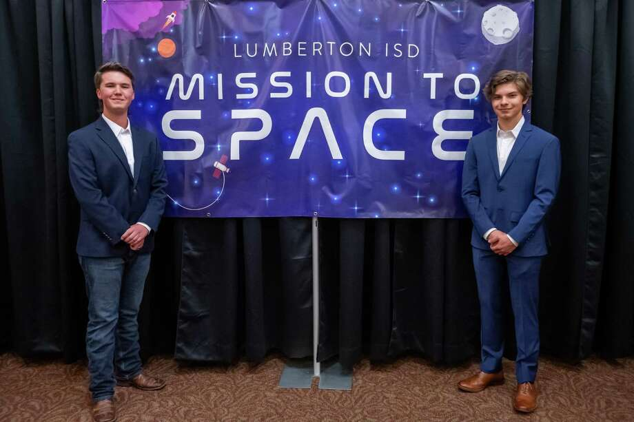 Austin Howard, left, and Lucas Mason stand by the Mission To Space banner in the school's performing arts center. The two students from Lumberton High School won a competition to send an experiment to the international space station this summer as part of the Student Spaceflight Experiments Program and the LISD held a night to honor them on February 13, 2020.  Fran Ruchalski/The Enterprise Photo: Fran Ruchalski/The Enterprise / 2019 The Beaumont Enterprise