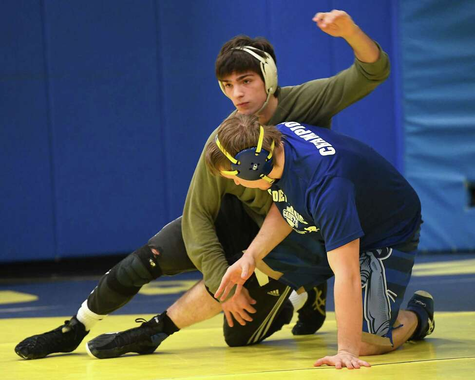 Averill Park junior wrestler Sean Malenfant, left, is seen at practice on Wednesday, Feb. 12, 2020 in Averill Park, N.Y. Malenfant is undefeated at 36- 0 entering the division l tournament. (Lori Van Buren/Times Union)