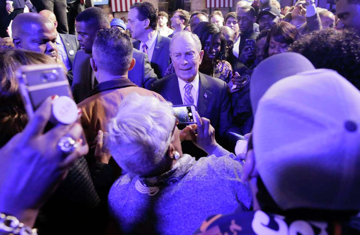 Democratic presidential primary candidate Mike Bloomberg shakes hands with supporters at the Buffalo Soldier Museum in Houston on Thursday, Feb. 13, 2020.