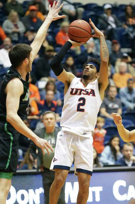 Runner guard Jhivvan Jackson cranks a shot over Jannson Williams in the first half as UTSA hosts Marshall in men's basketball at the Convocation Center on Feb. 13, 2020.