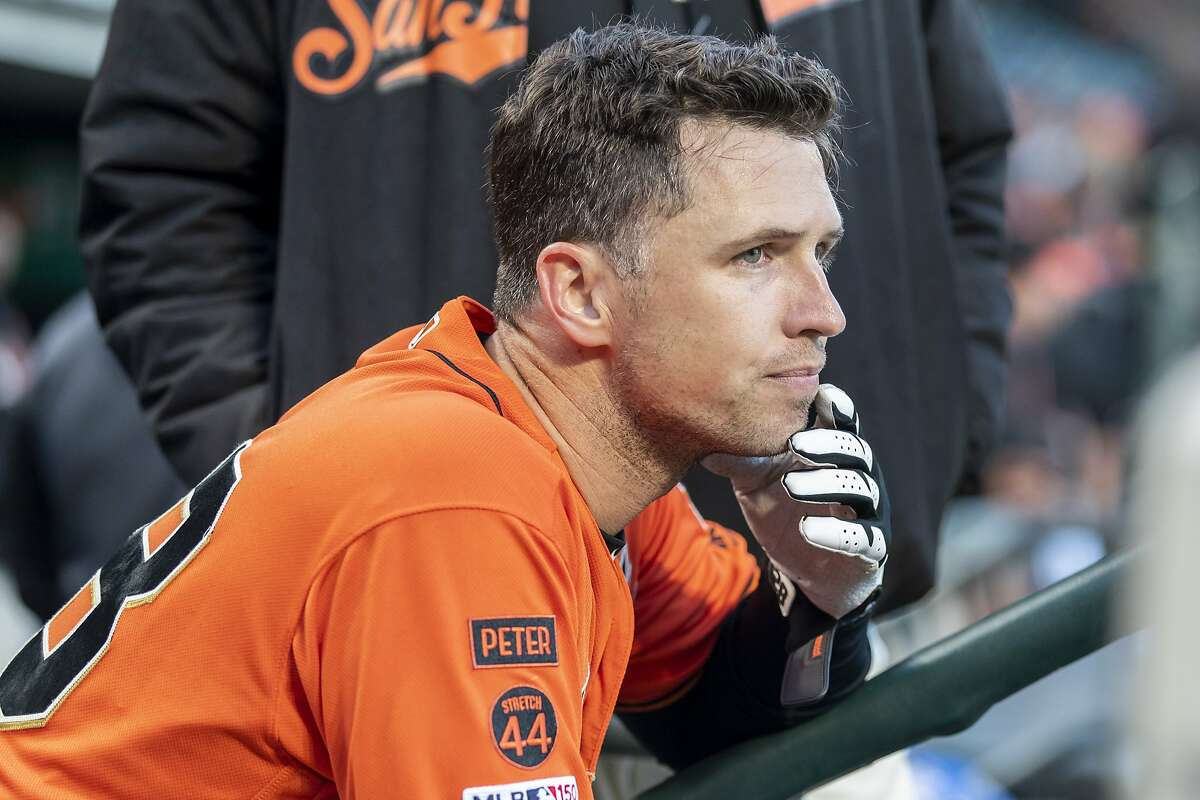 San Francisco Giants Catcher Buster Posey (28) watches his teammates bat during the major league baseball game between the Arizona Diamondbacks and San Francisco Giants on June 28, 2019 at Oracle Park in San Francisco, CA.
