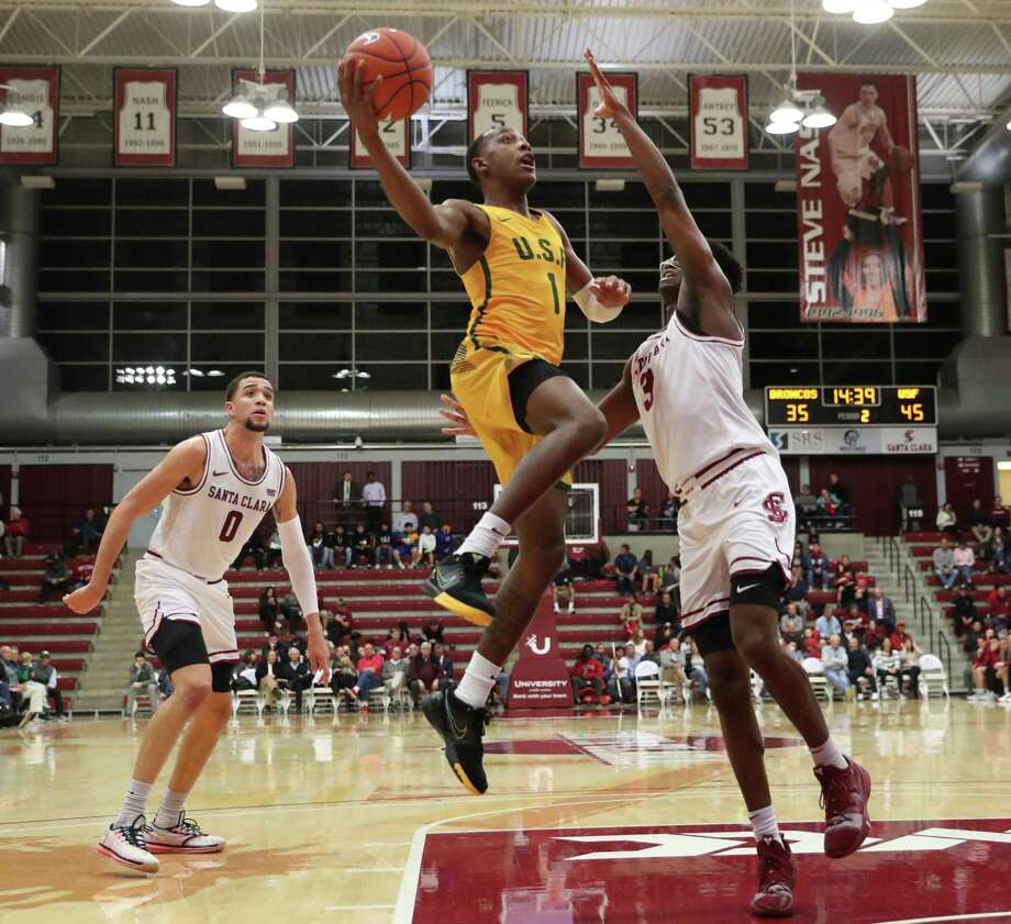 USF's Jamaree Bouyea takes it to the goal at Santa Clara. The Dons' point guard had game highs of 17 points and seven assists. The junior helped USF end its losing streak at three games. Photo: Don Jedlovec / Santa Clara Athletics