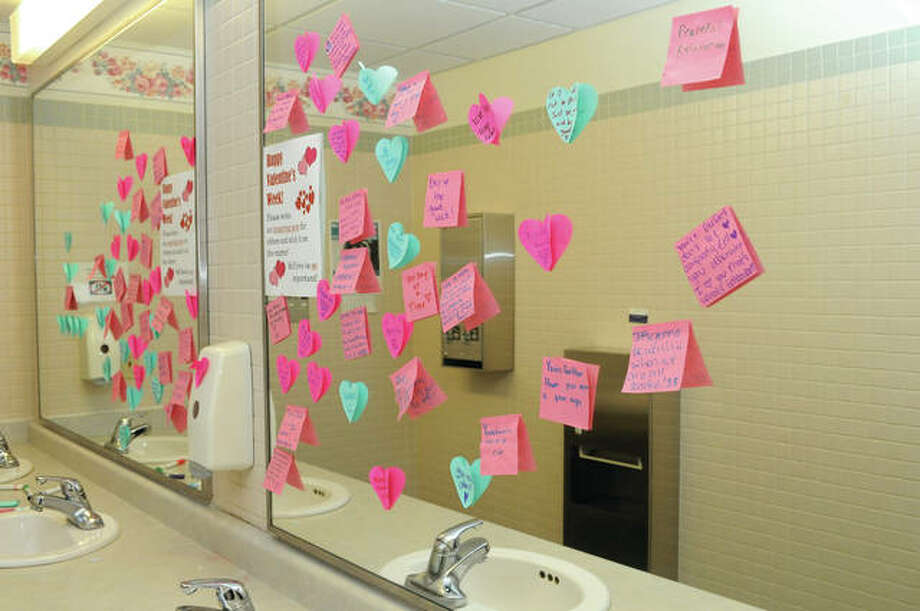 Inspirational notes for Valentine's Day fill a mirror at Lincoln Land Community College. Photo: Darren Iozia | Journal-Courier