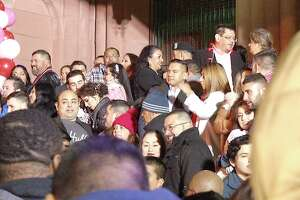 """More than 100 couples said """"I do"""" on the steps of the Bexar County courthouse at midnight in a mass Valentine's Day wedding ceremony Friday."""
