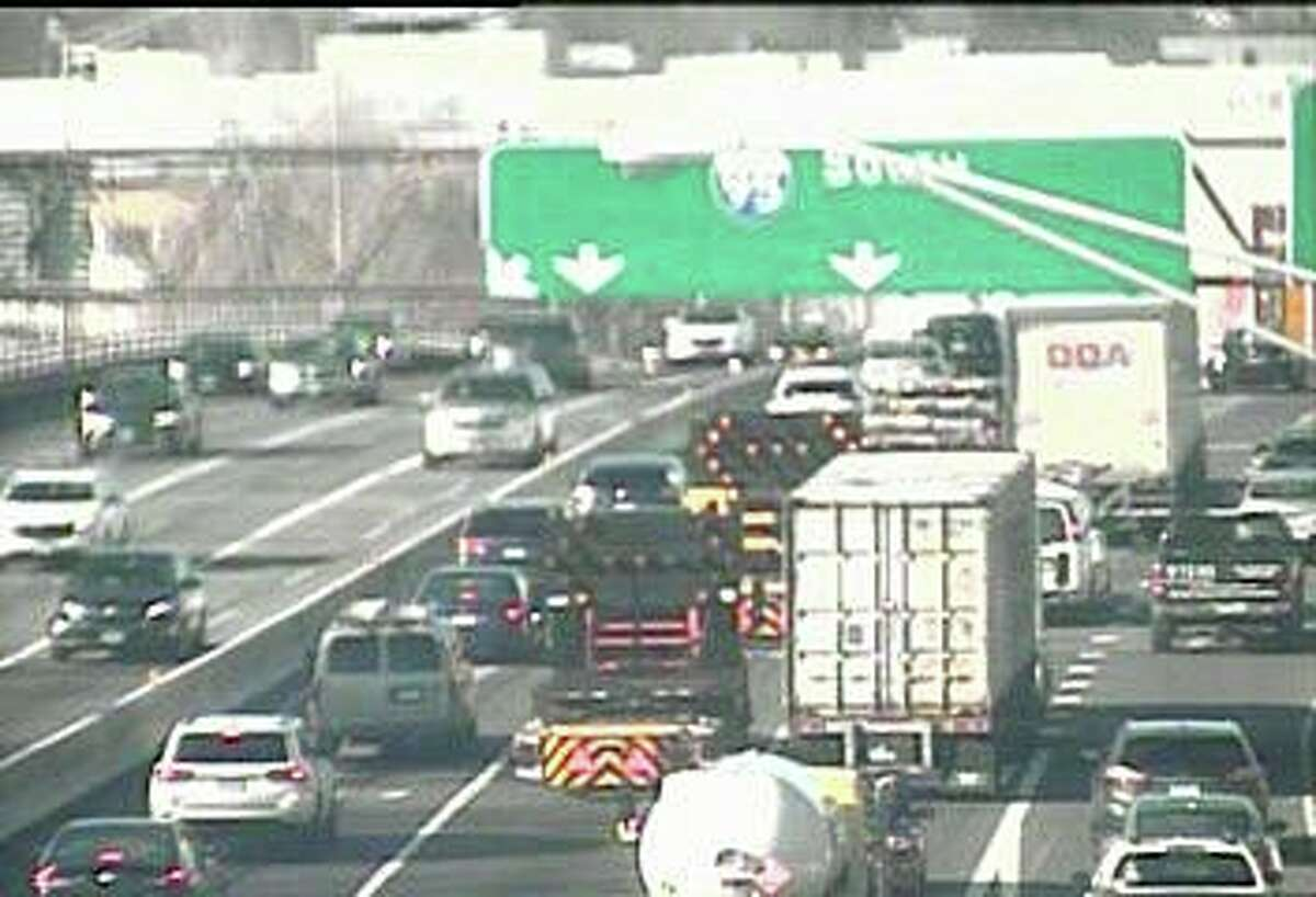 """The center lane of southbound I-95 is closed on the Yankee Doodle Bridge in Norwalk on Friday, Feb. 14, 2020. The state Department of Transportation says it needs to do some """"emergency"""" construction work on the bridge."""