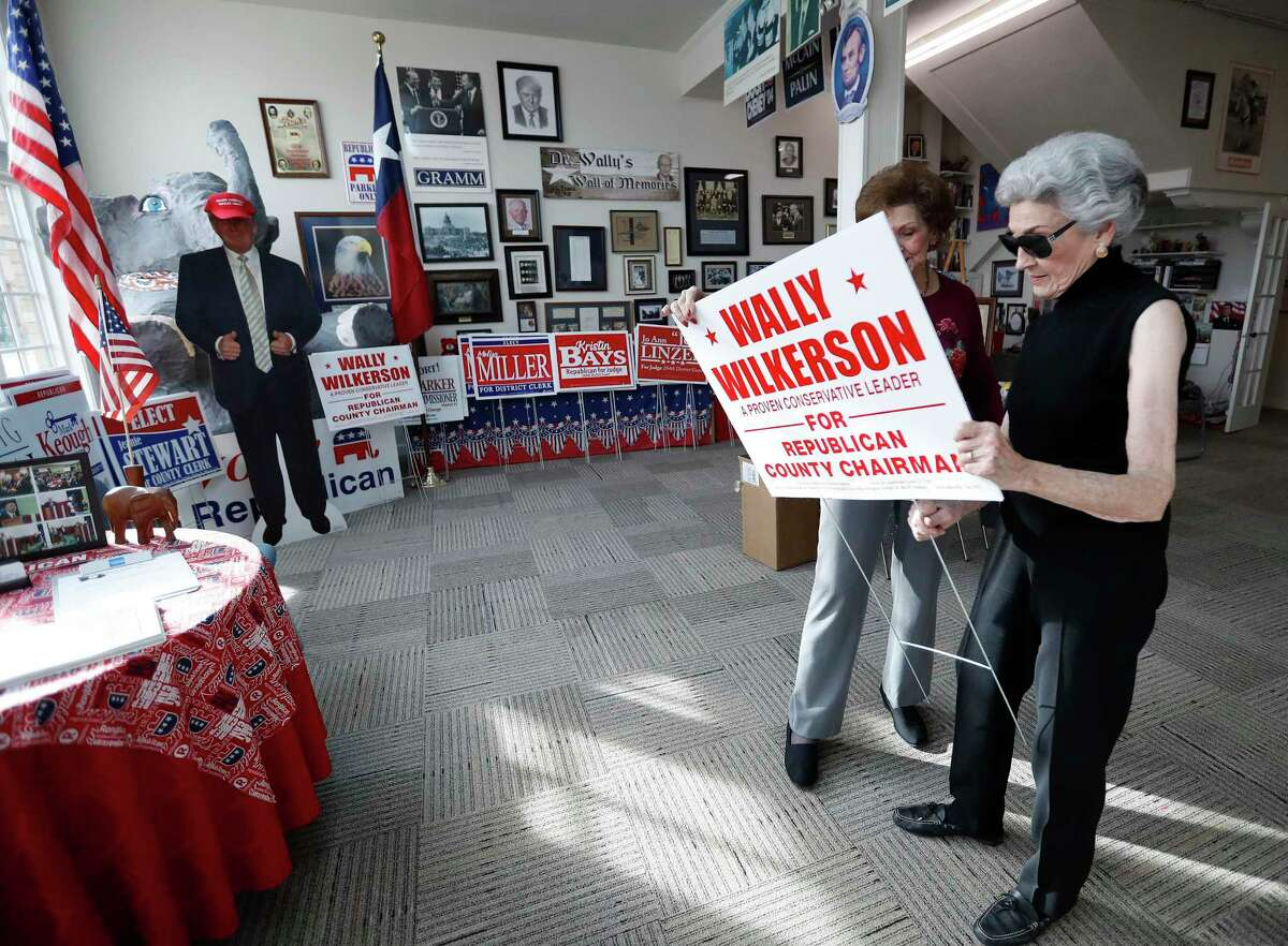 Neddie Wilkerson holds a yard sign for her husband Dr. Wally Wilkerson as she chats with Olene Heasley inside of the Montgomery County Republican Party headquarters, Thursday, Jan. 25, 2018, in Conroe. A look at what Trump voters in Montgomery County think of Trump a year into his presidency. ( Karen Warren / Houston Chronicle )