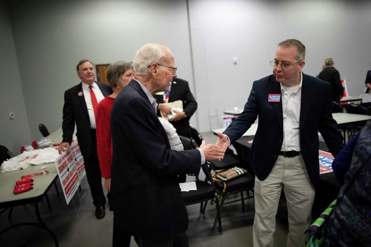 Bryan Christ, candidate for county chair of the Republican Party in Montgomery County greets Wally Wilkerson at the State and County Candidate Forum on Thursday, Feb. 6, 2020, in Montgomery. Wilkerson has served Montgomery County for 55 years as chairman of the Republican Party.