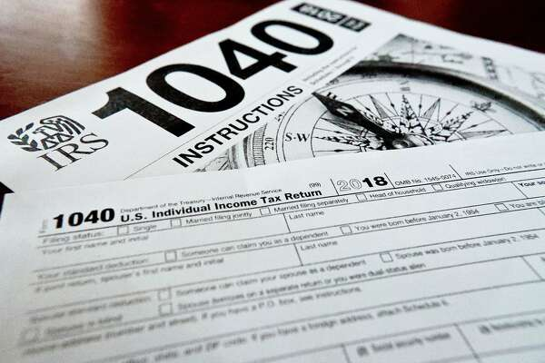 FILE- This Feb. 13, 2019, file photo shows multiple forms printed from the Internal Revenue Service web page that are used for 2018 U.S. federal tax returns in Zelienople, Pa. The majority of individual taxpayers in the U.S. are eligible to file their taxes for free, yet many may be unaware or confused by how to do so. � Improvements have been made and Free File should be easier to use in 2020. But, with tax season getting into full gear, users should be aware of the details of the service and alternatives. (AP Photo/Keith Srakocic, File)