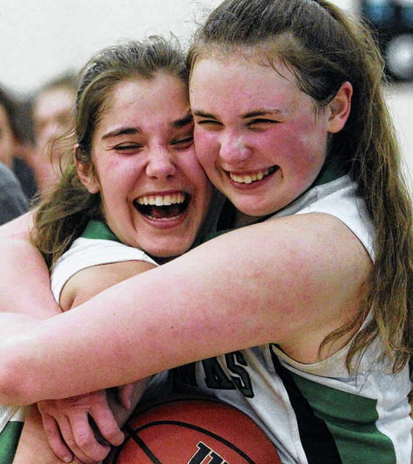 Carrollton's Ava Uhles (right) hugs teammate Libby Meuth after the Hawks beat Concord Triopia for the North Greene Class 1A Regional championship Thursday night in White Hall. Photo: Dennis Mathes | Hearst Midwest