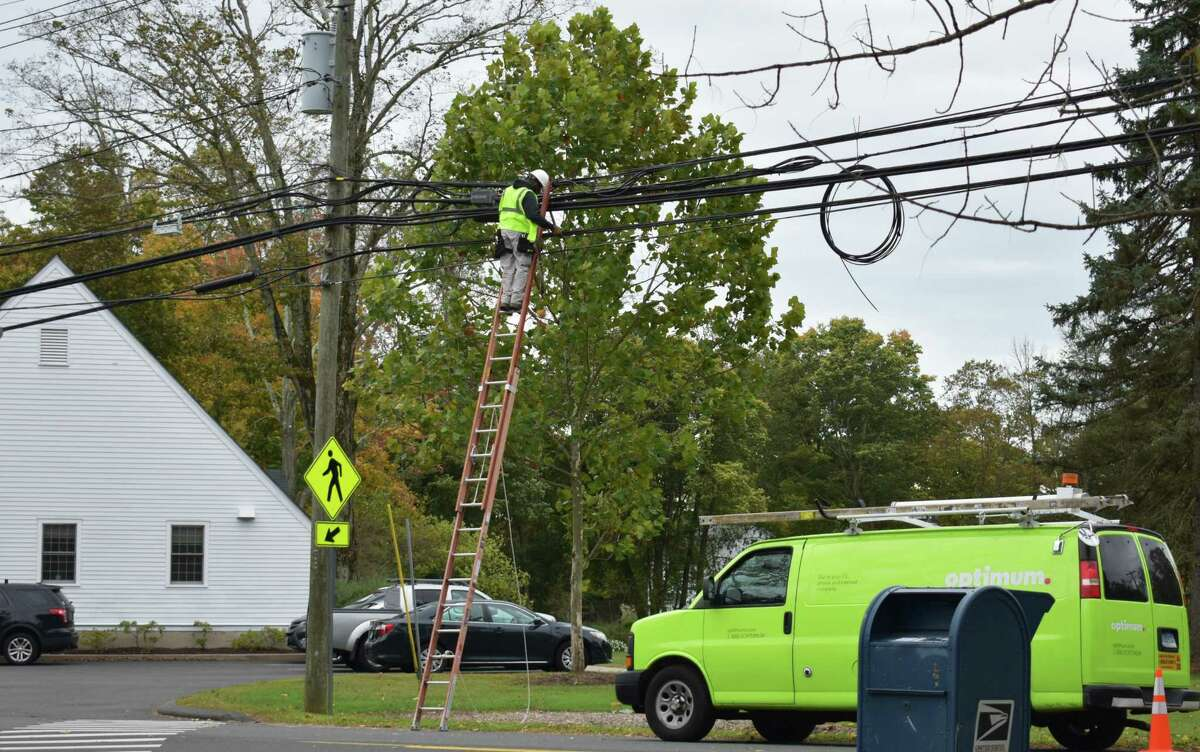 An Optimum field technician at work in October 2019 in Redding, Conn. Parent company Altice USA padded its base of broadband subscribers in the final months of the year, but incurred declining numbers of cable TV accounts.