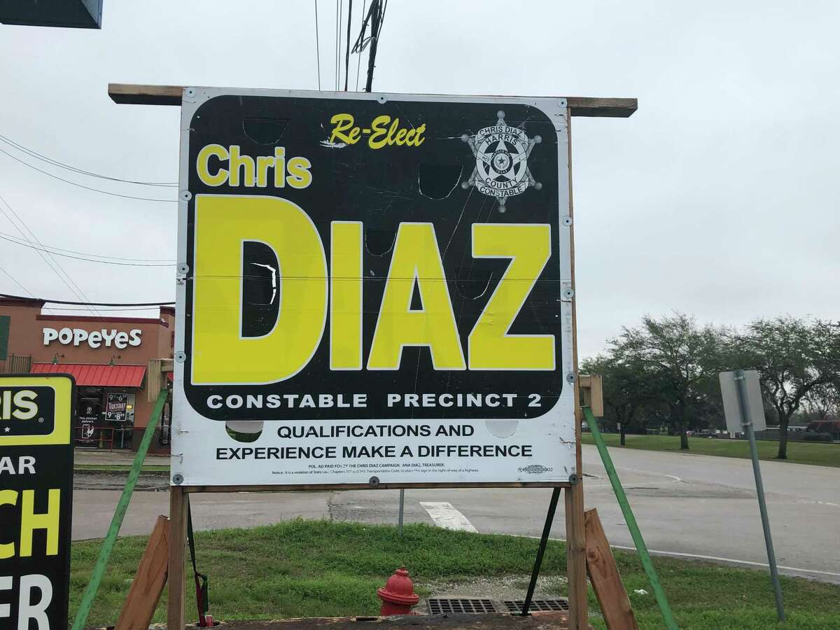 A sign in Jacinto City urges voters to re-elect Harris County Precinct 2 Constable Chris Diaz. More than a dozen current and former Precinct 2 employees say Diaz pressured them to contribute to his re-election campaigns.